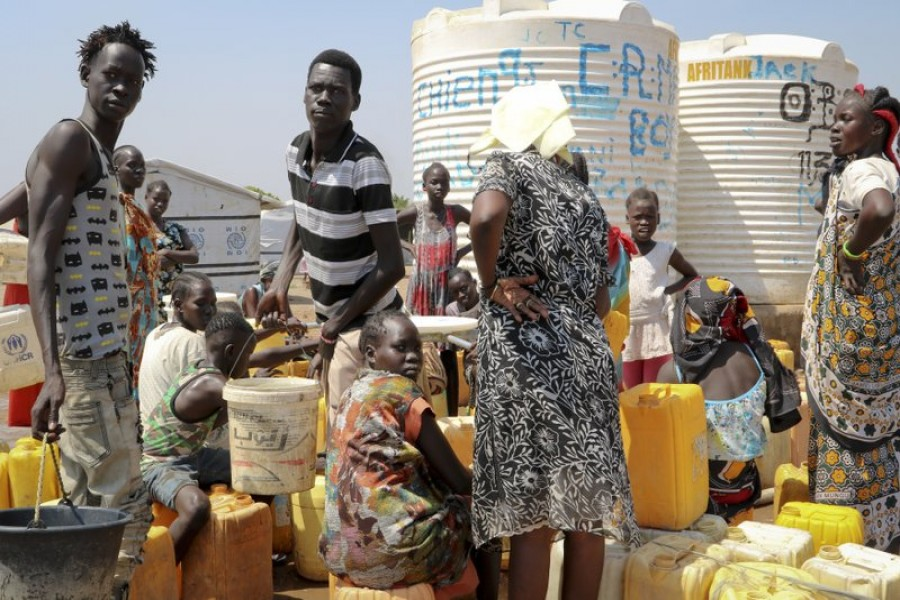 In this photo taken Tuesday, Jan 22, 2019, residents of the Mangateen camp for the internally-displaced line up to get water from a borehole, on the outskirts of the capital Juba, South Sudan. Tens of thousands of people are still sheltering in United Nations protected camps across the country, the legacy of an unprecedented decision by a UN peacekeeping mission to throw open its doors to people fleeing war. - AP Photo