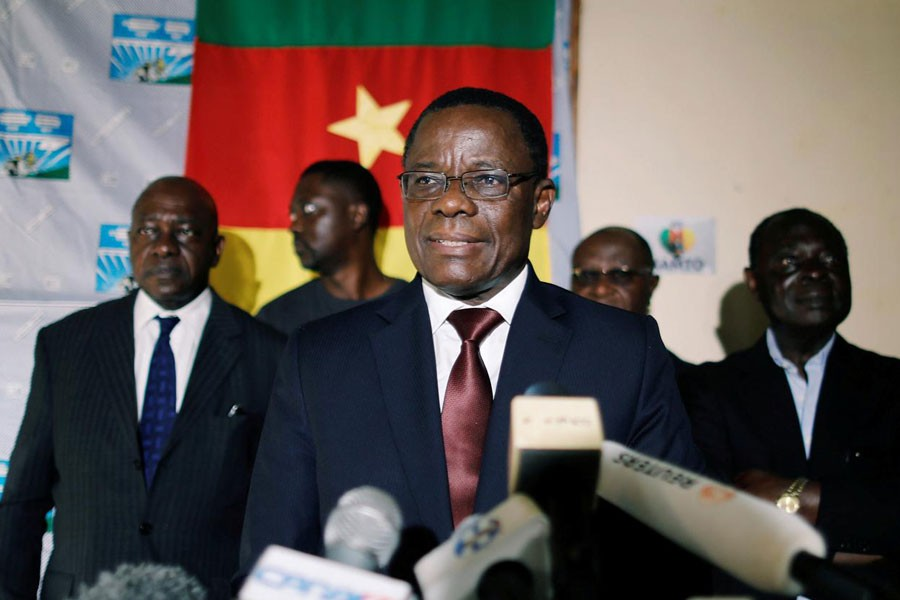 Maurice Kamto, a presidential candidate of Renaissance Movement (MRC), reacts as he holds a news conference at his headquarter in Yaounde, Cameroon October 8, 2018 - REUTERS/Zohra Bensemra/File Photo