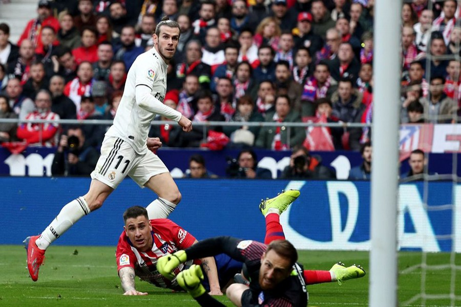 Bale scores his 100th goal for Real Madrid in derby win against Atletico — Reuters