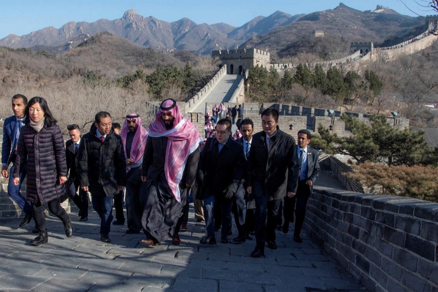 Saudi Arabia's Crown Prince Mohammed bin Salman walks with officials during his visit to Great Wall of China in Beijing, China, February 21, 2019. Courtesy of Saudi Royal Court/Handout via Reuters