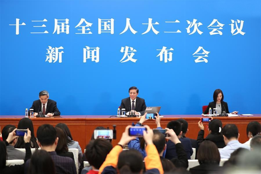 Zhang Yesui (C), spokesperson for the second session of the 13th National People's Congress (NPC), speaks during a press conference on the agenda of the session and the work of the NPC at the Great Hall of the People in Beijing, China on March 4, 2019 — Xinhua photo