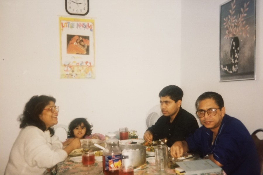 The photo shows Masud Karim wearing glasses and in front of him is Dilara Alo and next to him are his son Sohel and grand daughter