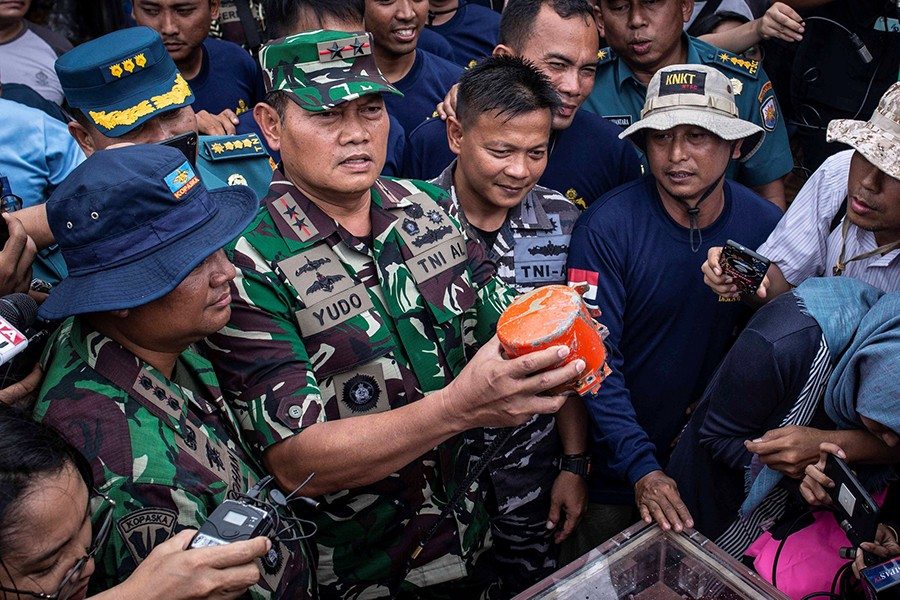 Indonesian navy commander Rear-Admiral Yudo Margono seen holding the cockpit voice recorder of the crash Lion Air JT610 in this Reuters file photo