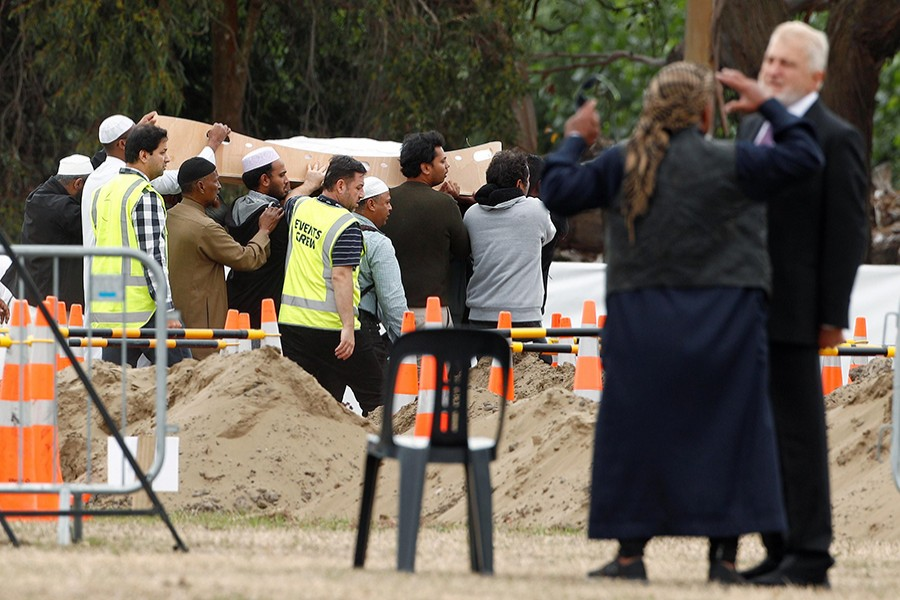 People attend the burial ceremony of Hussein Mohamed Khalil Moustafa, 70, a victim of the mosque attacks, at the Memorial Park Cemetery in Christchurch, New Zealand on March 21, 2019 — Reuters photo