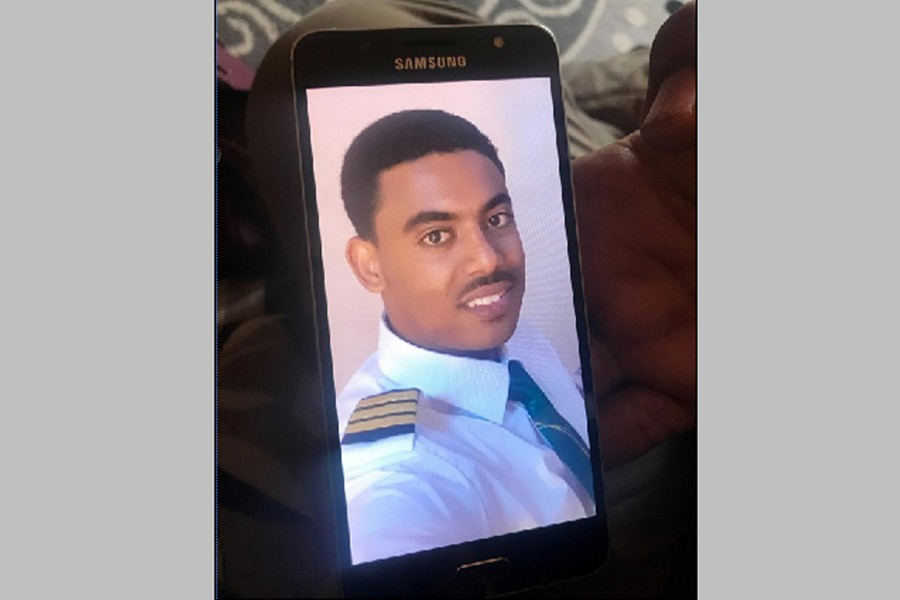 Menur Mohamed, brother to Ethiopian Airlines ET 302 First Officer Ahmednur Mohamed, holds his phone with a photograph of his brother during a Reuters interview in Addis Ababa, March 17, 2019. Reuters
