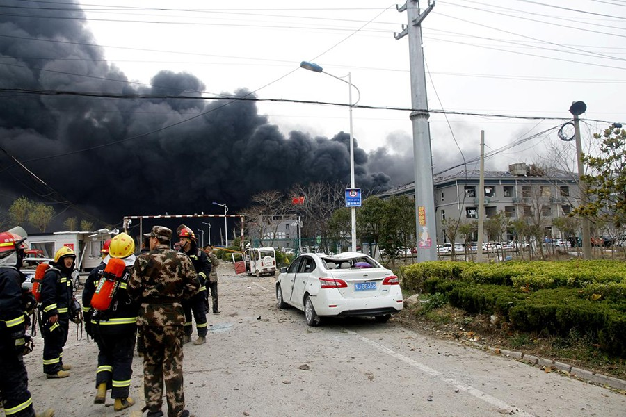 Rescue workers are seen near smoke following an explosion at a chemical industrial park in Xiangshui county, Yancheng, Jiangsu province, China — Reuters photo