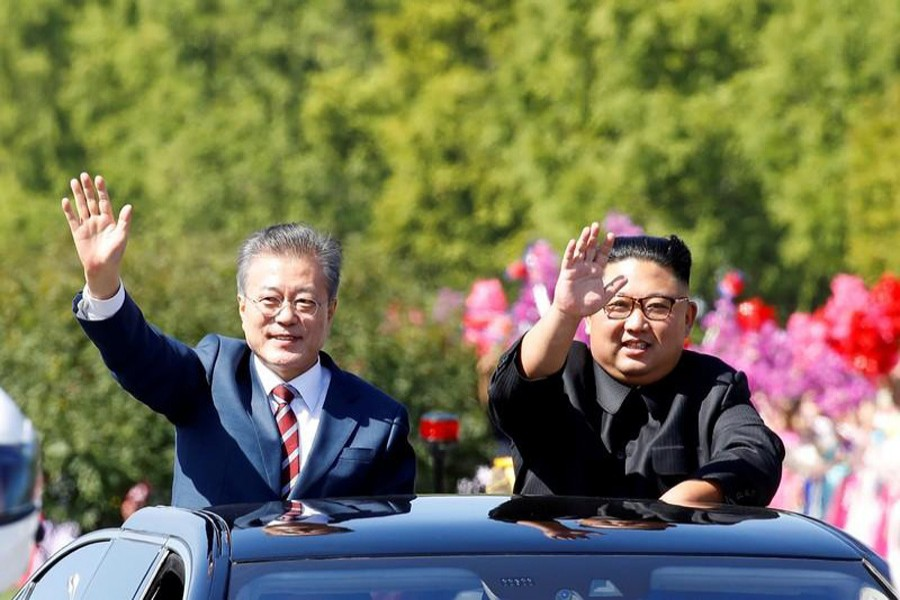 A file photo showing South Korean President Moon Jae-in (left) and North Korean leader Kim Jong Un waving during a car parade in Pyongyang, North Korea recently	— Reuters