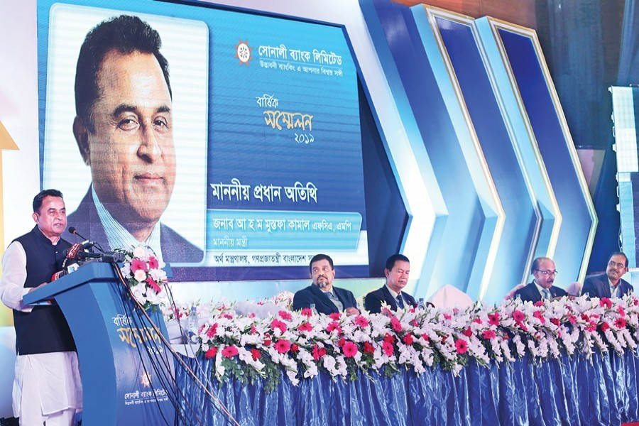 Finance Minister AHM Mustafa Kamal addressing the Annual Conference 2019 of Sonali Bank at the IDEB Bhaban in the city on Monday — FE Photo