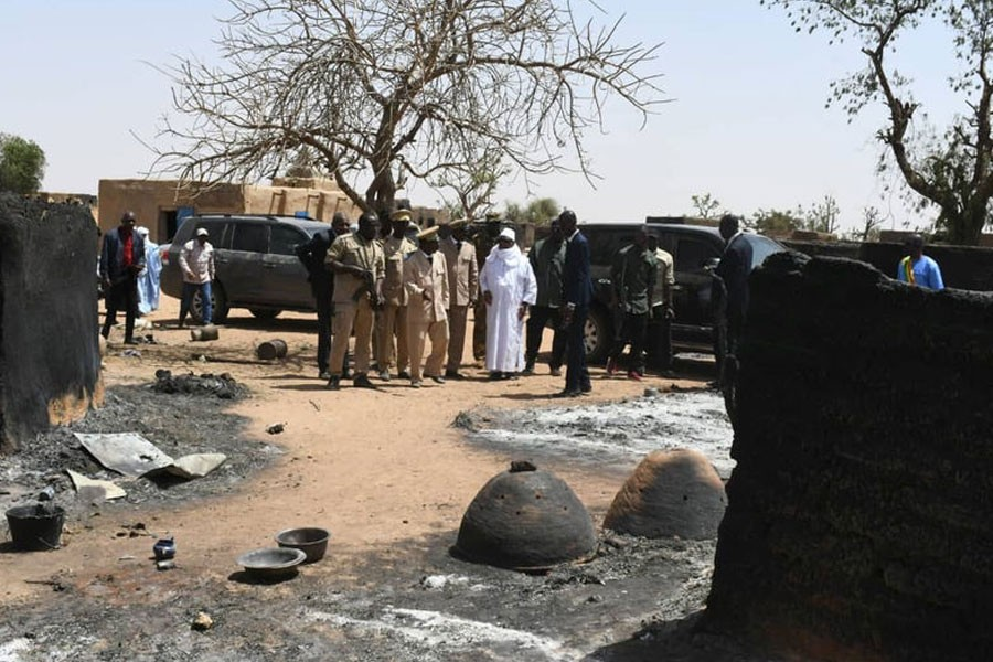 Mali's President Ibrahim Boubacar Keita inspects the damage after an attack by gunmen on Fulani herders in Ogossagou, Mali - Reuters