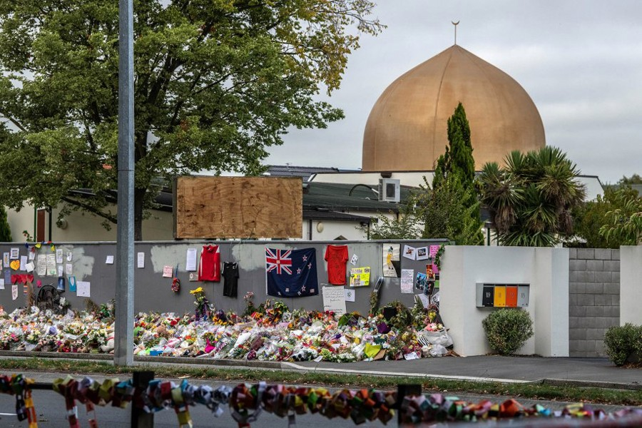 People leave messages and flowers for the victims of the Christchurch mosque attacks outside the mosque in Christchurch, New Zealand
