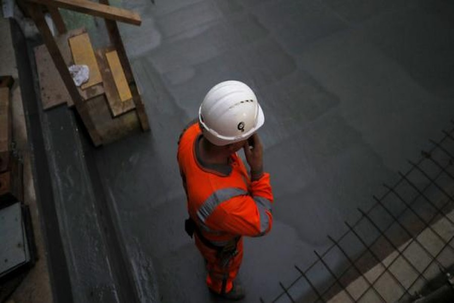 A construction worker stands on a concrete floor at the site for the new Crossrail station in Tottenham Court Road, in London, Britain, November 16, 2016. Reuters/Stefan Wermuth - Copyright Stefan Wermuth