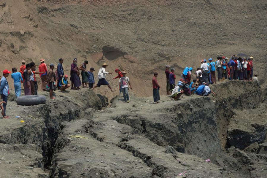 Local people look on in a jade mine where the mud dam collapsed in Hpakant, Kachin state, Myanmar on April 23, 2019 — Reuters photo