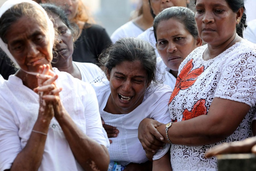 Mother of Shaini, 13, who died during a string of suicide bomb attacks on churches and luxury hotels on Easter Sunday, mourns at her funeral outside St Sebastian's Church in Negombo, Sri Lanka, April 24, 2019. Reuters