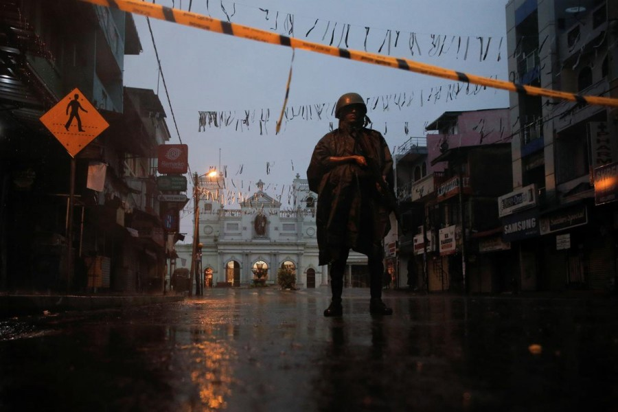 A soldier stands guard at St Anthony's Shrine during heavy rain, days after a string of suicide bomb attacks on churches and luxury hotels across the island on Easter Sunday, in Colombo, Sri Lanka, April 25, 2019. Reuters