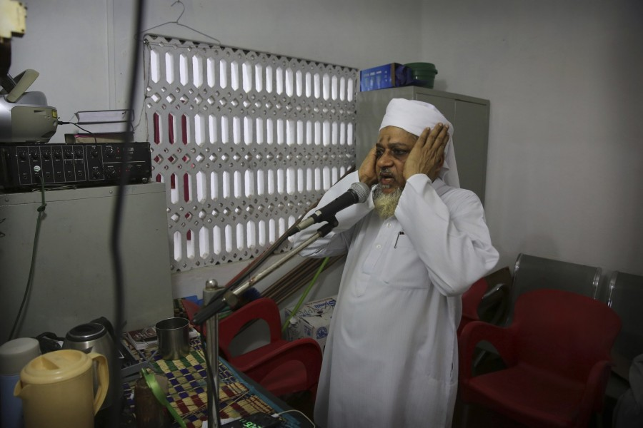 An imam calls for Friday prayers from a mosque, in Colombo, Sri Lanka, Friday, April 26, 2019. -AP