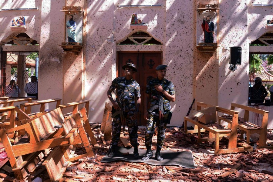 Sri Lankan military stand guard inside a church after an explosion in Negombo, Sri Lanka, April 21, 2019. Reuters/Files