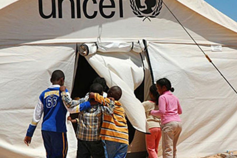 Children enter a UNICEF-supported tent school at the Shousha transit camp on the Libyan border with Tunisia - UNICEF/Heifel Ben Youssef