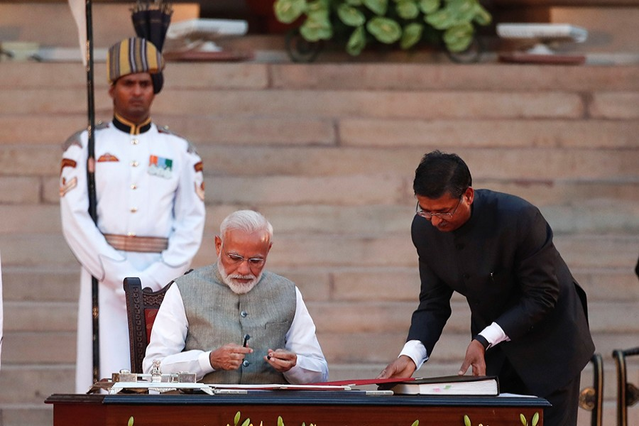 India's Prime Minister Narendra Modi signs documents after his oath during a swearing-in ceremony at the presidential palace in New Delhi, India on May 30, 2019 — Reuters photo