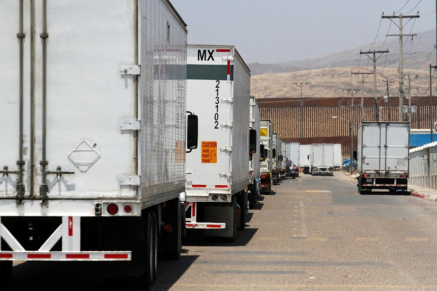 Trucks wait in queue for border customs control, to cross into the U.S., at the Otay border crossing in Tijuana, Mexico on June 7, 2019 — Reutersphoto