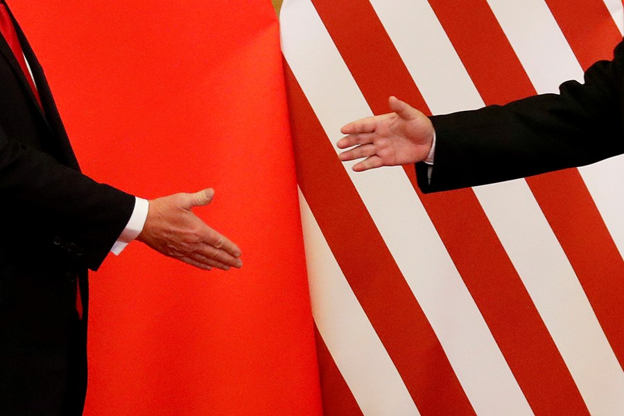 US President Donald Trump (right) and China's President Xi Jinping shake hands after making joint statements at the Great Hall of the People in Beijing, China on November 9, 2017 — Reuters/Files