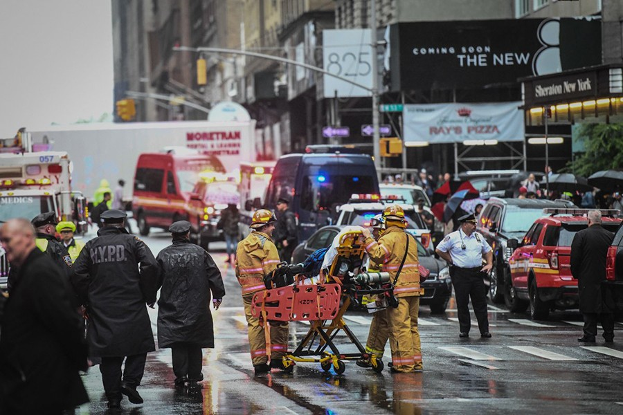 Emergency services personnel at the scene after a helicopter crashed atop a building in Times Square and caused a fire in the Manhattan borough of New York, New York, US on June 10, 2019 — Social media photo
