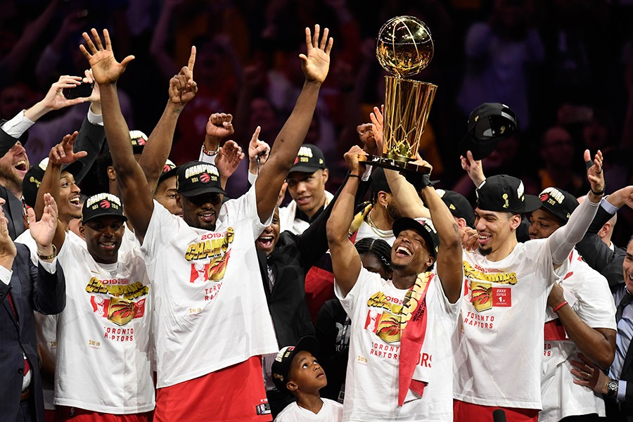 Toronto Raptors guard Kyle Lowry (centre left) holds Larry O'Brien NBA Championship Trophy after defeating the Golden State Warriors in Game six of the NBA Finals in Oakland, California, USA on Thursday, June 13, 2019 — The Canadian Press photo