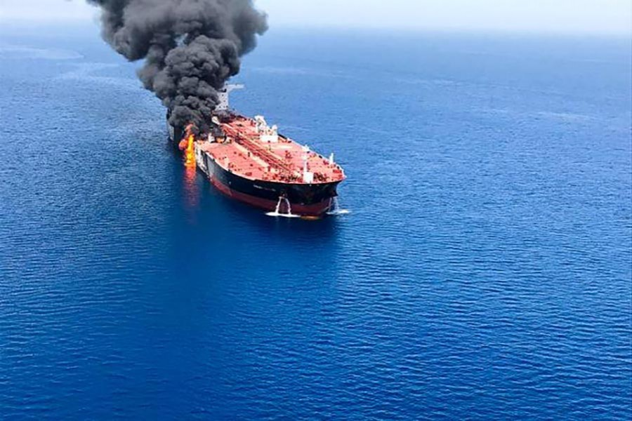 An oil tanker is seen after it was attacked at the Gulf of Oman, in waters between Gulf Arab states and Iran, on Thursday. -Reuters Photo