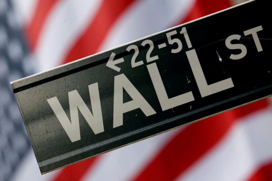 A street sign is seen in front of the New York Stock Exchange on Wall Street in New York, February 10, 2009. Reuters/File Photo