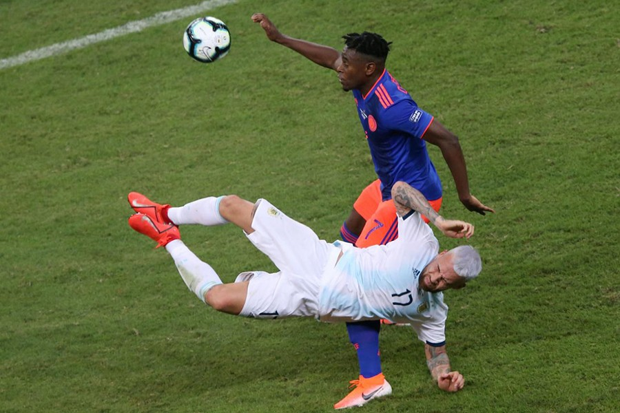 Colombia's Duvan Zapata in action with Argentina's Nicolas Otamendi — Reuters action image