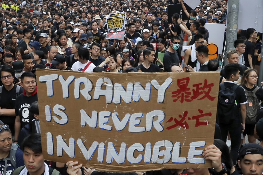 Tens of thousands of protesters carry posters and banners march through the streets as they continue to protest an extradition bill, Sunday, June 16, 2019, in Hong Kong. Hong Kong residents were gathering Sunday for another mass protest over an unpopular extradition bill that has highlighted the territory's apprehension about relations with mainland China - AP Photo/Kin Cheung