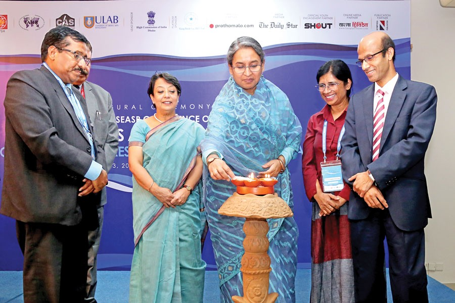 Education Minister Dr Dipu Moni MP inaugurating the eighth SSEASR conference Rivers and Religion by lighting a traditional lamp