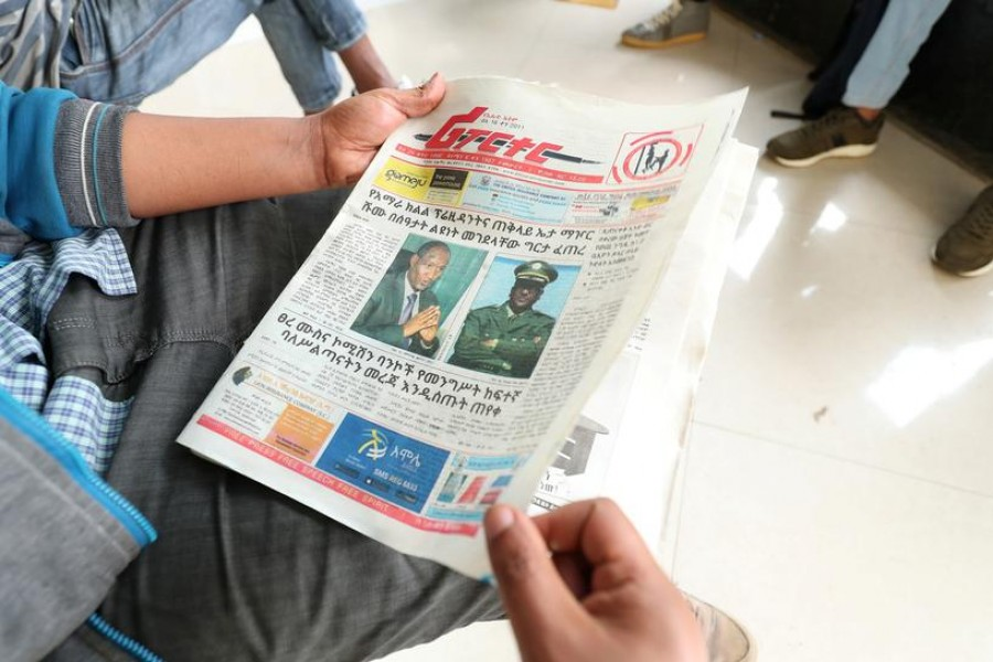 An Ethiopian man reads a newspaper with the pictures of Amhara state President Ambachew Mekonnen, killed in the region's main city Bahir Dar, and of Army Chief of Staff Seare Mekonnen, who was shot by his bodyguard, on a street in Addis Ababa, Ethiopia June 24, 2019 - REUTERS/Tiksa Negeri