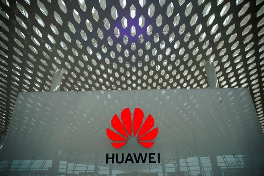 A Huawei company logo at the Shenzhen International Airport in Shenzhen, Guangdong province, China Jun 17, 2019. Reuters/Files