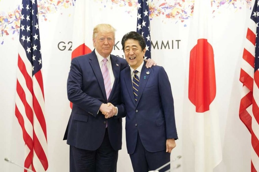 US President Donald Trump shakes hands with Japan's Prime Minister Shinzo Abe during the G20 leaders summit in Osaka, Japan, June 28, 2019. Reuters
