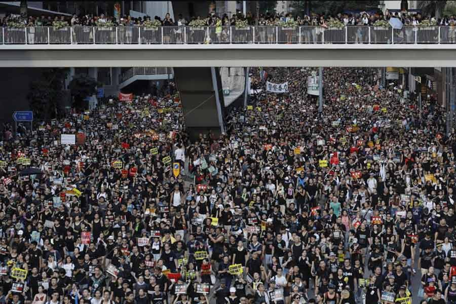 Protesters take part in a rally on Monday, July 1, 2019, in Hong Kong. Combative protesters tried to break into the Hong Kong legislature Monday as a crowd of thousands prepared to start a march in that direction on the 22nd anniversary of the former British colony's return to China. -AP Photo