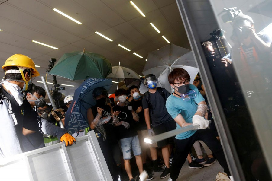 Protesters breaking into the Legislative Council building during the anniversary of Hong Kong's handover to China in Hong Kong, China on Monday	— Reuters