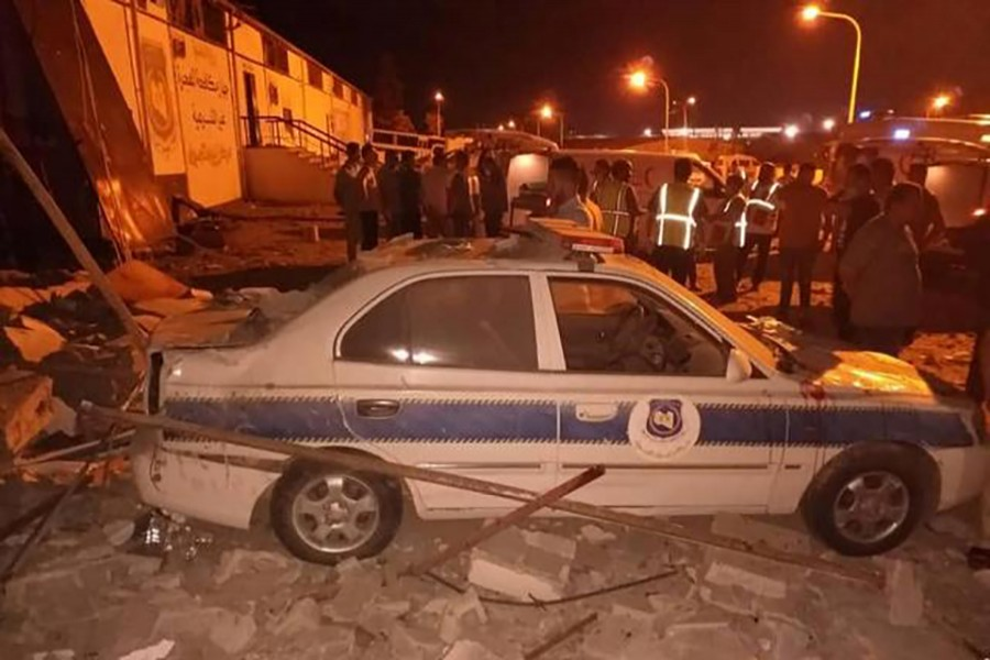Security and emergency personnel work at site of an air strike at a detention centre for mainly African migrants, in a suburb of Tripoli, Libya on Wednesday in this image obtained from social media. Courtesy of Jihaz Mukafahat Alhijrat Alghyr Shareia via Reuters