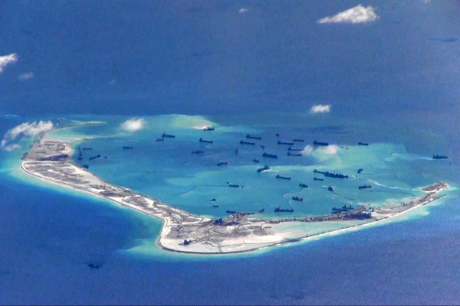 Chinese dredging vessels are purportedly seen in waters around Mischief Reef in the disputed Spratly Islands in the South China Sea, in this still image from video taken by a P-8A Poseidon surveillance aircraft of US Navy — via Reuters/Files