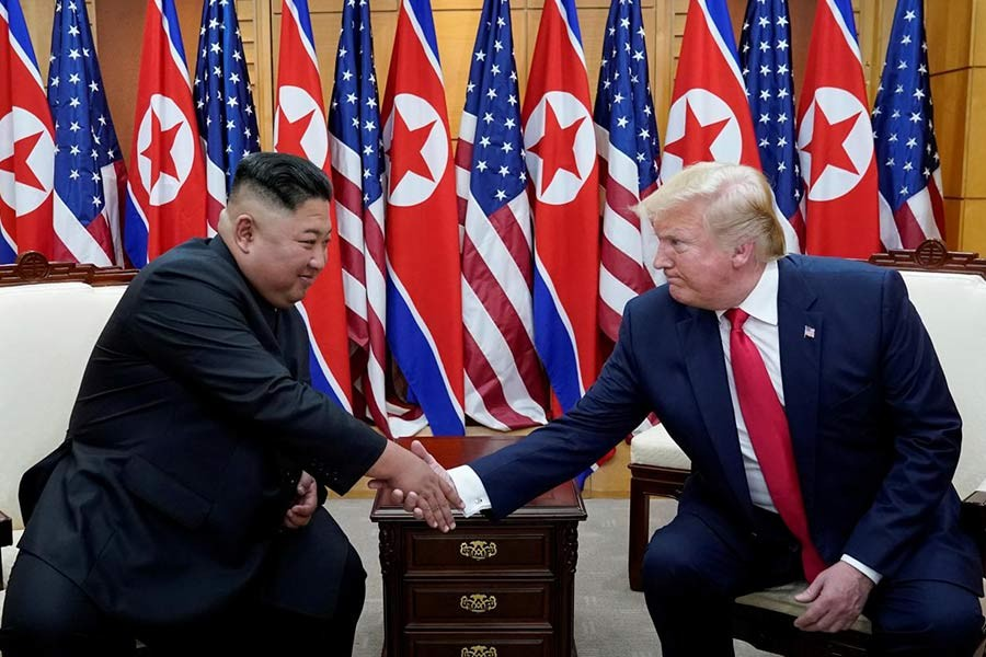 Trump shakes hands with Kim Jong-Un as they meet at the demilitarised zone separating the two Koreas, in Panmunjom, S.Korea on June 30.        — Photo: Reuters
