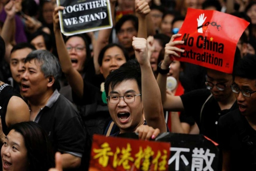 Anti-extradition bill protesters shout slogans as they march to West Kowloon Express Rail Link Station in Hong Kong, China July 7, 2019. Reuters