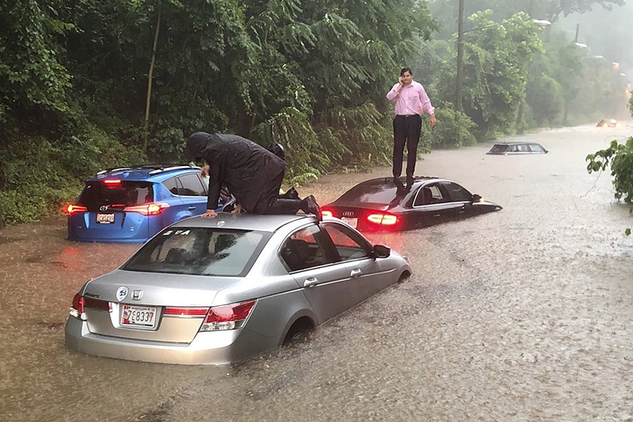 Motorists are stranded on a flooded section of Canal Road in Washington during a heavy rainstorm on Monday — AP photo