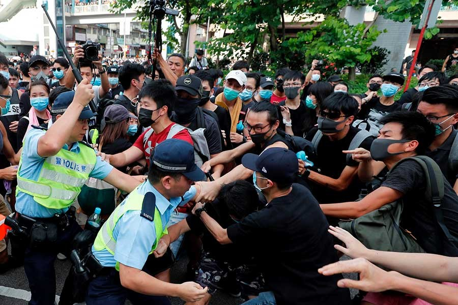 Police try to disperse pro-democracy activists after a march at Sheung Shui, a city border town in Hong Kong, China on Saturday. -Reuters Photo