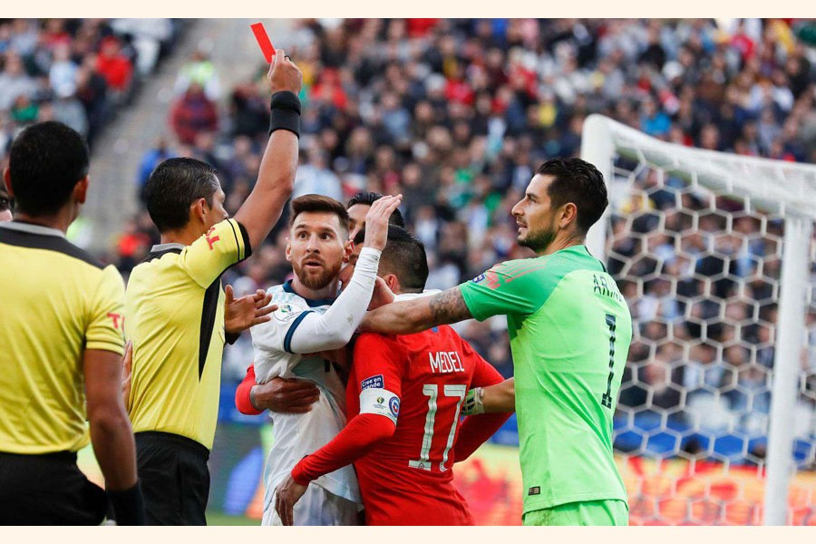File photo: Argentina's Lionel Messi and Chile's Gary Medel scuffling as referee Mario Diaz, from Paraguay, left, shows the red card to both of them during Copa America third-place football match at the Arena Corinthians in Sao Paulo, Brazil — AP