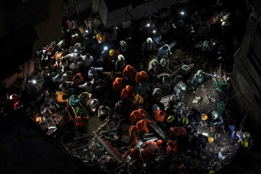 Rescue workers search for survivors at the site of a collapsed building in Mumbai, India, on July 16, 2019 — Reuters photo
