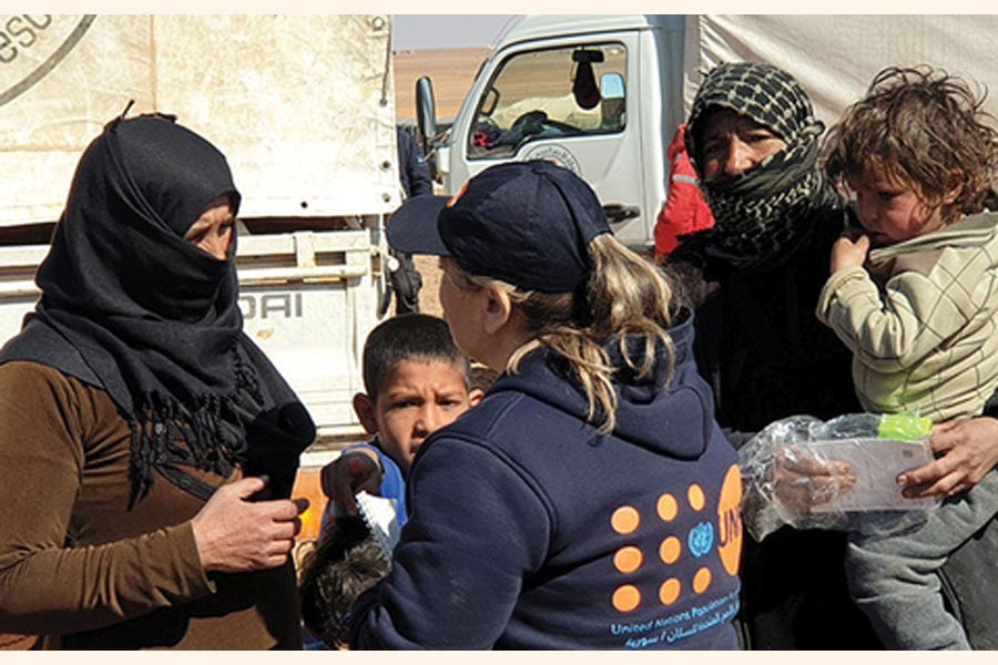 As part of the largest-ever humanitarian convoy by the United Nations and the Syrian Arab Red Crescent, UNFPA delivered on February 16, 2019 critical reproductive health supplies, hygiene and dignity kits to women and girls in the remote Rukban area of South-east Syria. Some 118 trucks brought life-saving assistance to the makeshift settlement, where more than 40,000 people are stranded in the desert. 	—Photo courtesy:  UN in Syria via the Internet
