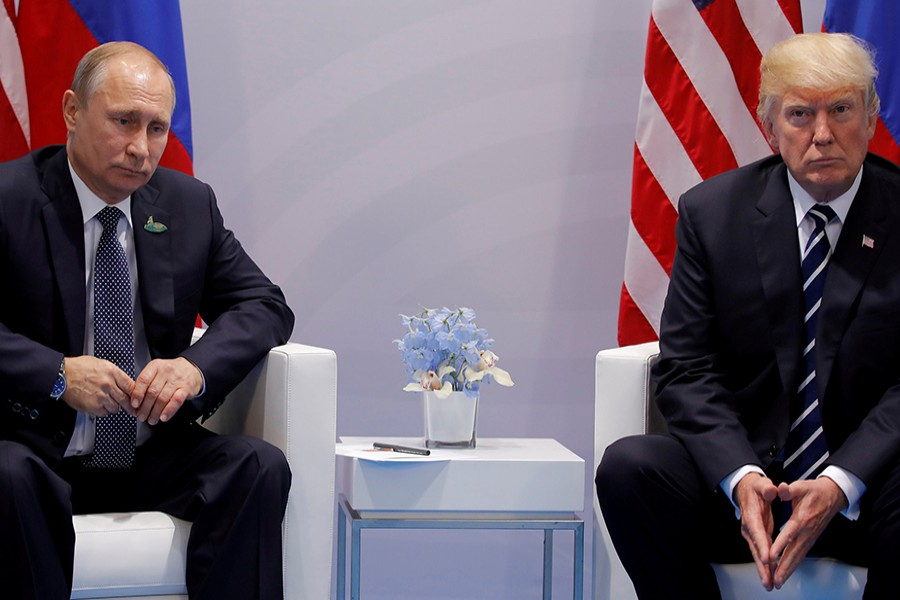 US President Donald Trump meets with Russian President Vladimir Putin during their bilateral meeting at the G20 summit in Hamburg, Germany on July 7, 2017 — Reuters/Files