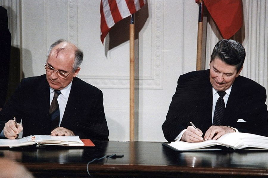 US President Ronald Reagan (R) and Soviet President Mikhail Gorbachev sign the Intermediate-Range Nuclear Forces (INF) treaty in the White House December 8 1987. - REUTERS