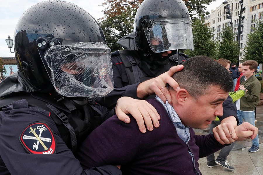 Law enforcement officers detain a participant in a rally calling for opposition candidates to be registered for elections to Moscow City Duma, the capital's regional parliament, in Moscow, Russia on August 3, 2019 — Reuters photo