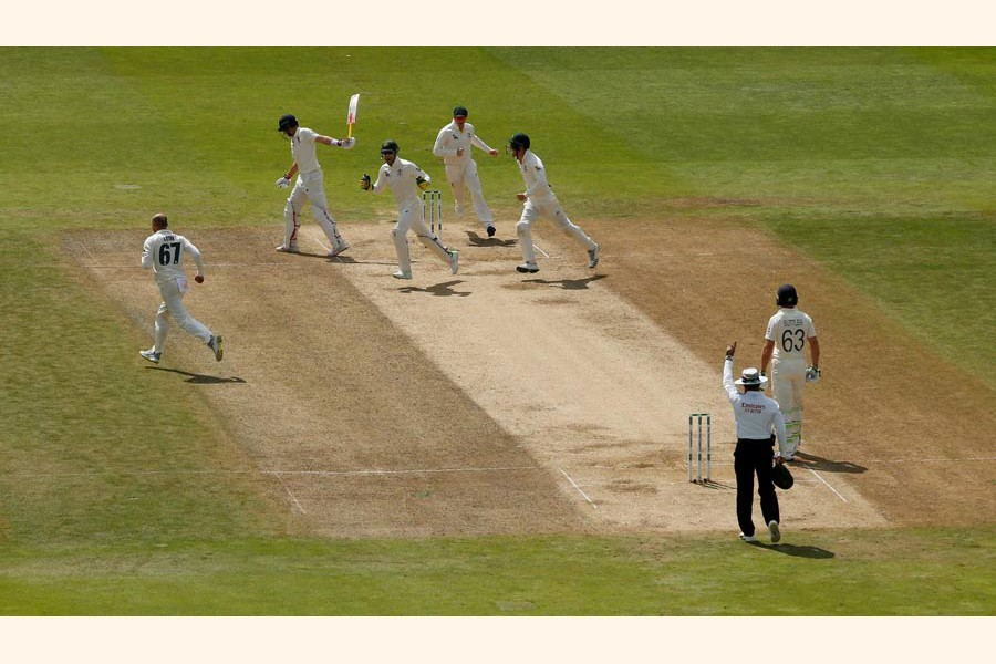 England's Joe Root is dismissed after being caught out by Australia's Cameron Bancroft off the bowling of Nathan Lyon during play on the fifth day of the first Ashes cricket Test match at Edgbaston in Birmingham, central England on Monday— Reuters