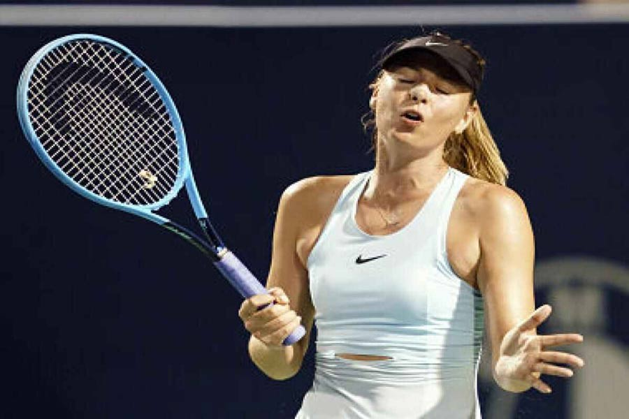 Russia's Maria Sharapova reacting during play against Estonia's Anett Kontaveit during a first round match on Day 3 of the Rogers Cup at Aviva Centre on Monday— AP